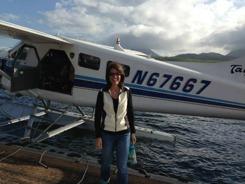 Rene jumping on a floatplane in Ketchikan Alaska