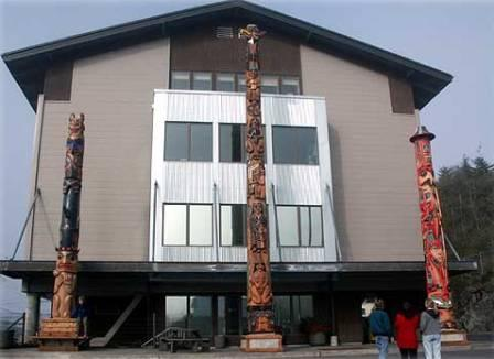 Three gorgeous Native American totem poles stand in front of the KIC building in Ketchikan Alaska