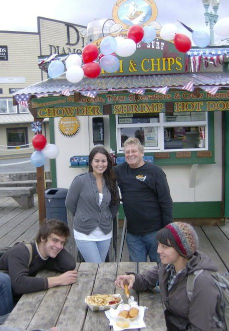 Scott & Ale in front of Alaskan Surf fish and chips in Ketchikan, AK