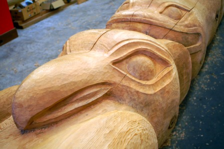 An Eagle and Whale is carved on the Native American Totem Poles at Potlatch Park