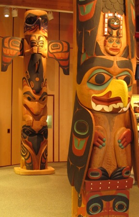 Two of the three Totem Poles inside the Southeast Alaska Discovery Center in Ketchikan Alaska