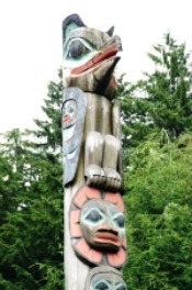 The Raven Stealing the Sun native american totem pole in downtown Ketchikan Alaska