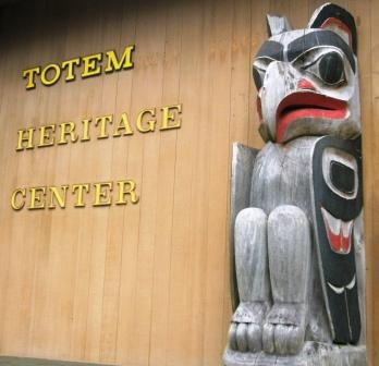 Posts in front of The Totem Heritage Center in Ketchikan Alaska