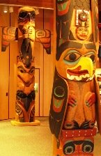 Three Totem Poles are inside the Discovery Center in Ketchikan Alaska